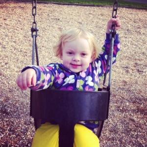 Haddie swings at park